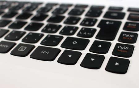 White laptop keyboard with black arrow buttons Reklamní fotografie