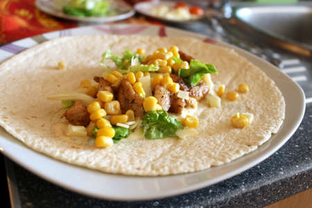 Healthy tortilla with meat, salad, cheese and corn Reklamní fotografie