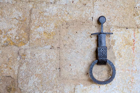 eponymous: Symbol of the sword in the stone on the knocker at the entrance of the chapel of the knight Galgano founder of the eponymous abbey in Siena Stock Photo