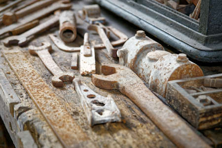 consumed: Old workbench full of disused tools, concept consumed, worn Stock Photo