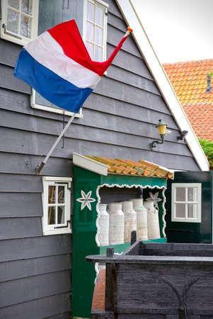 dutch typical: Dutch flag waving on a typical house