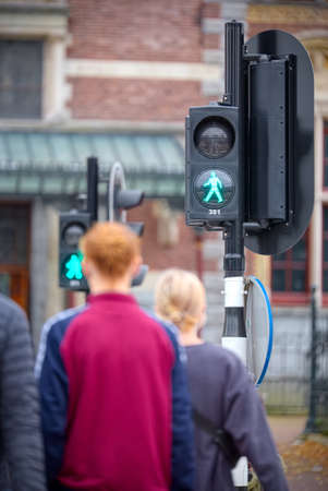 unharmed: Pedestrians waiting at the traffic lights green Stock Photo
