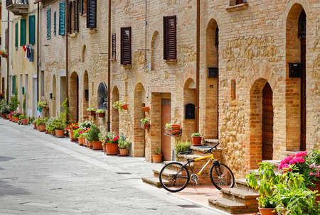 pienza: Bicycle parked in an alley in Pienza (Tuscany)