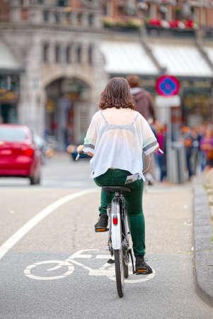 dutch girl: Girl on bicycle in Amsterdam Stock Photo