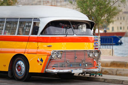 itinerant: Vintage maltese buses used as a traveling shop Stock Photo