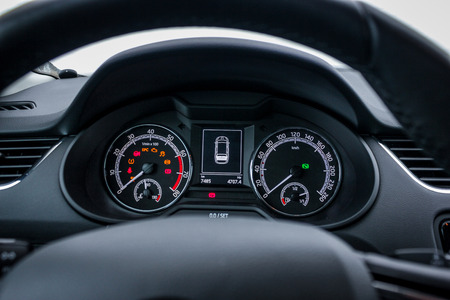 Illuminated dashboard with speedometer and rpm meter