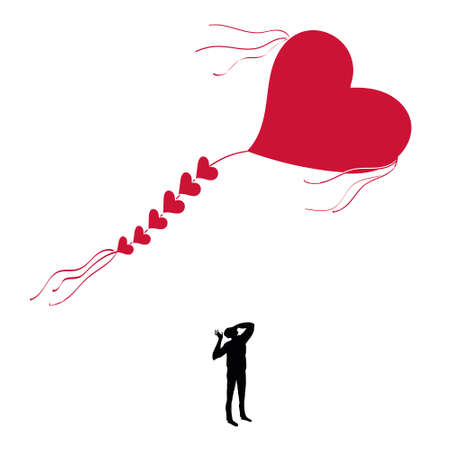 Man with a kite in the shape of heart. Stock Photo