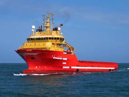 Offshore supply vessel underway to offshore installation.