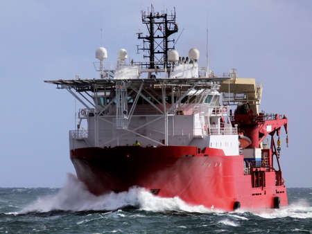 Offshore Diving Support Vessel underway at sea to offshore installation.