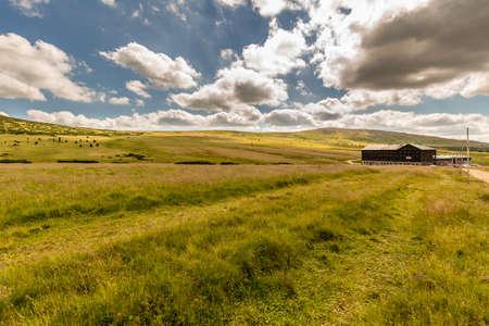 krkonose: Landscape with grass field and nice clouds in Krkonose, Czech Republic