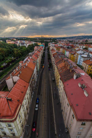 View of Prague taken from Nuselsky bridge on sunset captures typical local architecture from aerial perspective. Famous Vysehrad castle is behind it. Editorial