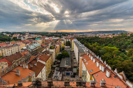 View of Prague taken from Nuselsky bridge on sunset captures typical local architecture from aerial perspective. Famous Vysehrad castle is behind it. Banco de Imagens