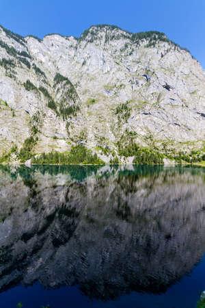mirroring: Mountain peak mirroring in lake Obersee