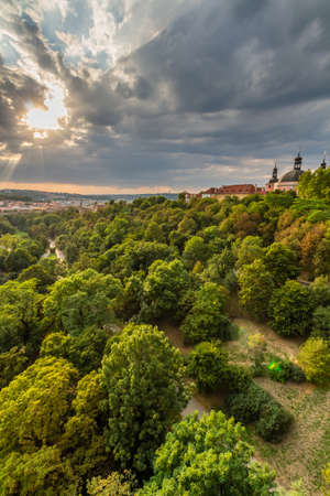 architectural architectonic: View of Prague taken from Nuselsky bridge on sunset captures typical local architecture from aerial perspective. Famous Vysehrad castle is behind it. Stock Photo