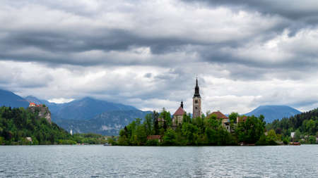 Amazing View On Bled Lake, Island,Church And Castle With Mountain Range (Stol, Vrtaca, Begunjscica) In The Background-Bled, Slovenia, Europe Stock Photo