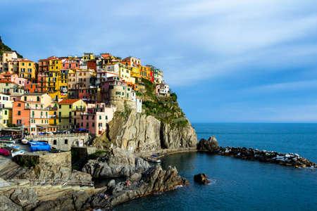 spezia: Colorful traditional houses on a rock over Mediterranean sea, Manarola, Cinque Terre, Italy Stock Photo