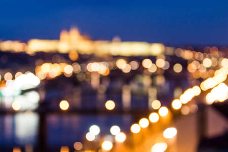 Defocused bokeh of Prague and Vltava river from Vysehrad - Romantic view after misty sunset with emotional color filter - European capital of bohemian Czech Republic