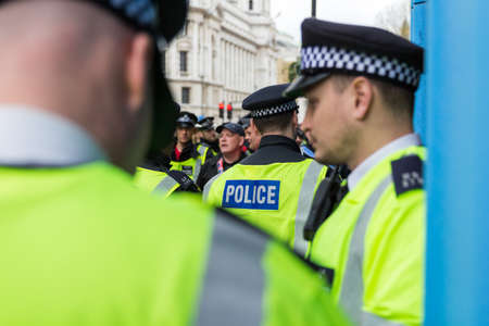 London, UK - 1st April, 2017. Police trying to keep in order protest against Islamists, ISIS. Editorial