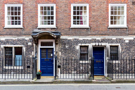 front house: Typical street scene in the central London district with familiar architecture facades to urban housing.
