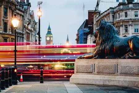 Street view of Trafalgar Square towards Big Ben at night in London, UK