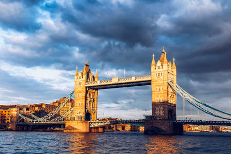 riverbank: Tower Bridge with reflections at sunset in London, UK. Stock Photo