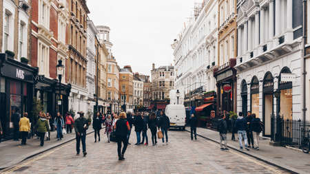 entertaining: London, England - April 4, 2017: Covent Garden market, one of the main tourist attractions in London, known as restaurants, pubs, market stalls, shops and public entertaining.