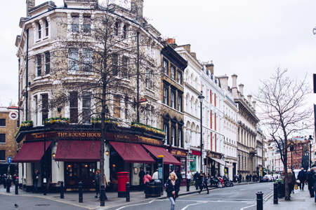 London, England - April 4, 2017: Covent Garden market, one of the main tourist attractions in London, known as restaurants, pubs, market stalls, shops and public entertaining.