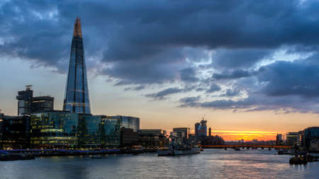shard: Tower Bridge, the Shard, city hall and business district in the background at night, London, Uk. Stock Photo