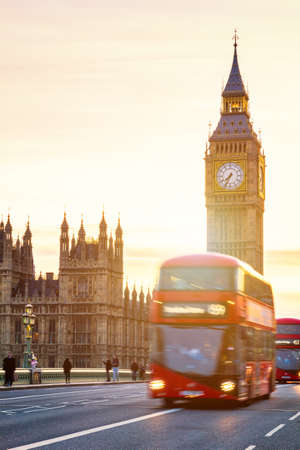 The Big Ben, House of Parliament and double-decker bus blurred in motion, London, UK