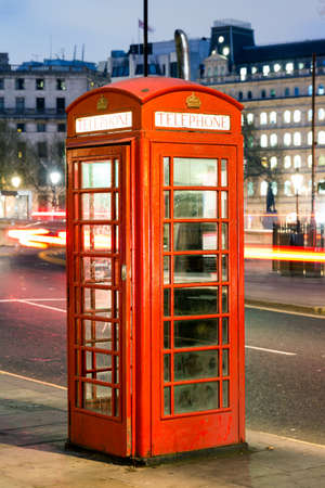 antique booth: London Telephone box at night with streaming vehicle headlights