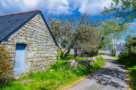 Street view of beautiful village of Rostudel former fishing village, Parc naturel regional dArmorique. Finistere department, Camaret-sur-Mer. Brittany (Bretagne), France. Stock Photo