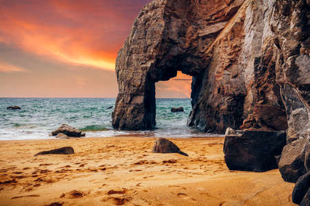Spectacular natural cliffs and stone arch Arche de Port Blanc and beautiful famous coastline, Brittany (Bretagne), France, Europe