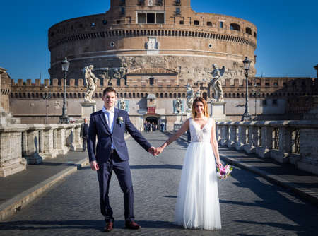 castel: Bride and groom wedding poses in front of Castel SantAngelo, Rome, Italy