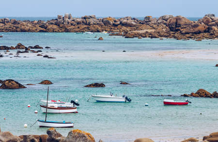 ploumanach: Boats in the port on the Pink Granite Coast (cote de granite rose in french). Brittany (Bretagne), France