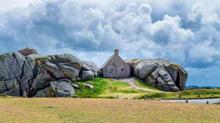 House between the rocks in Meneham village, Kerlouan, Finistere, Brittany (Bretagne), France