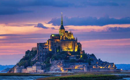Mont Saint-Michel view in the sunset light. Normandy, northern France 스톡 콘텐츠