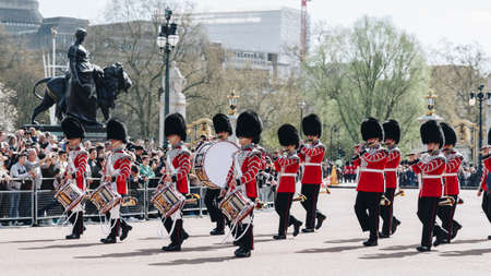 London, England - April 4, 2017: Royal Guards parade during traditional Changing of the Guards ceremony near Buckingham Palace. This ceremony is one of the most popular tourist attractions in London.