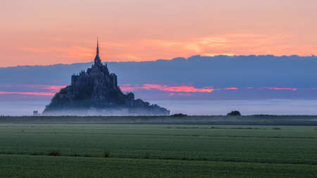 Mont Saint-Michel view in the sunrise light. Normandy, northern France 版權商用圖片