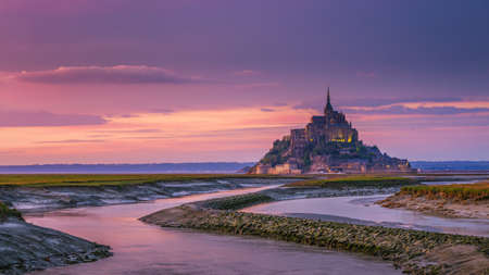 Mont Saint-Michel view in the sunset light. Normandy, northern France Imagens