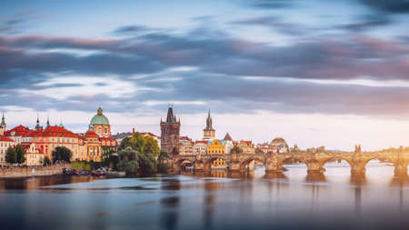 Charles Bridge (Karluv Most) and Lesser Town Tower, Prague in summer at sunset, Czech Republic Stock Photo