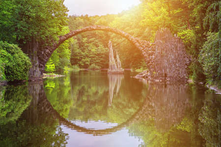 Rakotz bridge (Rakotzbrucke) also known as Devils Bridge in Kromlau, Germany. Reflection of the bridge in the water create a full circle. Stock Photo