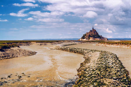 Beautiful panoramic view of famous Le Mont Saint-Michel tidal island with blue sky. Normandy, northern France Stock Photo