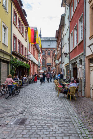 Heidelberg, Germany - May 6, 2017: Marketplace crowded with tourists and Town Hall in Heidelberg in Germany. Heidelberg is a city in Baden-Wurttemberg in Germany.