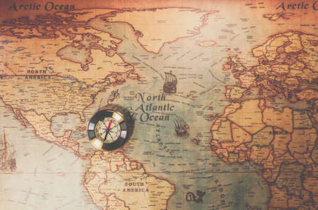 Columbus day and world map with compass Stock Photo - 94316536