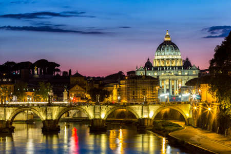 Vatican City, Rome, Italy, Beautiful Vibrant Night image Panorama of St. Peters Basilica, Ponte St. Angelo and Tiber River at Dusk in Summer. Reflection of The Papal Basilica of St. Peter Stock Photo