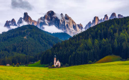 St Magdalena Village Church at the foot of the Dolomites, Church of St. John in Ranui, Alps, Italy