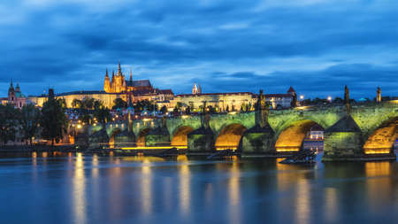 Famous iconic image of Prague castle and Charles Bridge, Prague, Czech Republic. Concept of world travel, sightseeing and tourism.