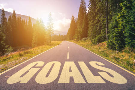 Goals word written on road in the mountains