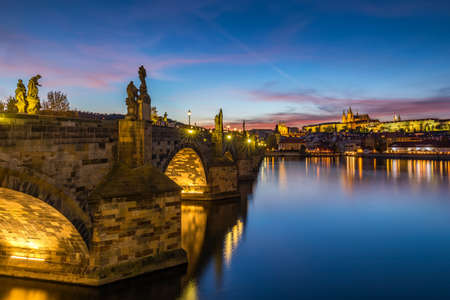 Famous Charles bridge in the sunset light, beautiful scenary and one of the iconic landmarks in Prague. Czech Republic.