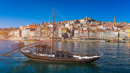 Oporto or Porto city skyline, Douro river, traditional boats and Dom Luis or Luiz iron bridge. Porto, Portugal, Europe.